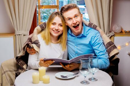 portret: Portret happy young couple having breakfast in cafe Stock Photo