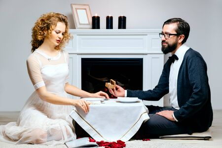 two people with others: Portrait of a couple enjoying each others company in a romantic dinner Stock Photo