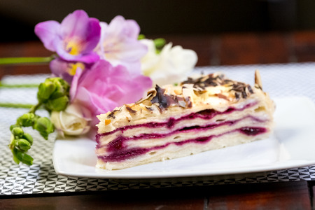chocolaty: Piece of delicious cake Blueberry Vanilla Cake Piece of cake on a white plate with flowers close-up.