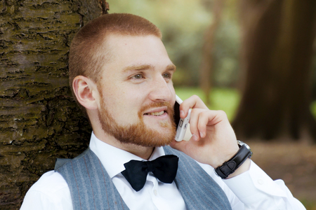 Man on smartphone - young business man talking on smart phone. Stock Photo