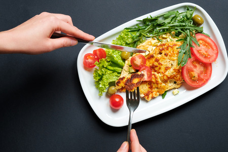 Tomato omelette served with fresh salad. Stock Photo