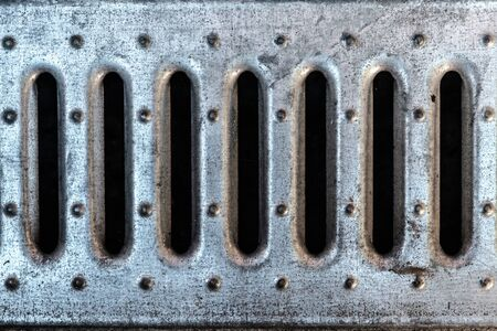 metal grill in underground drain water background Stock Photo
