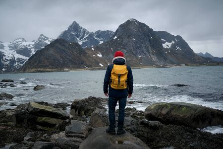 travel and adventure background, hiker with backpack enjoying landscape in Lofoten, Norway Stockfoto