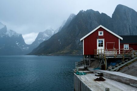 Typical red rorbu fishing huts with sod roof on Lofoten islands in Norway Stock fotó