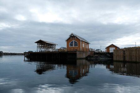 Norway rorbu houses and mountains rocks over fjord landscape scandinavian travel view Lofoten islands Stock fotó