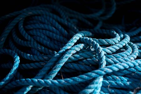 Close up of worn out thick mooring rope on wooden pier. Can use as banner Stok Fotoğraf