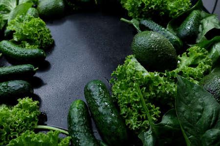 Green background of fresh lettuce leaves avocado cucumber zucchini