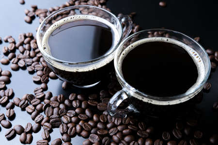 Horizontal shot of espresso and roasted coffee beans, close-up Stock fotó