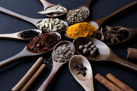 Colourful various herbs and spices for cooking on dark background. Stok Fotoğraf