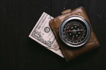 vintage banknotes on wooden board with old vintage compass Stok Fotoğraf