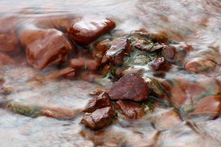 brooklet: Red rocks in a creek