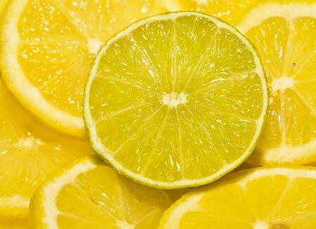 Round cut lime segment around lemon pieces