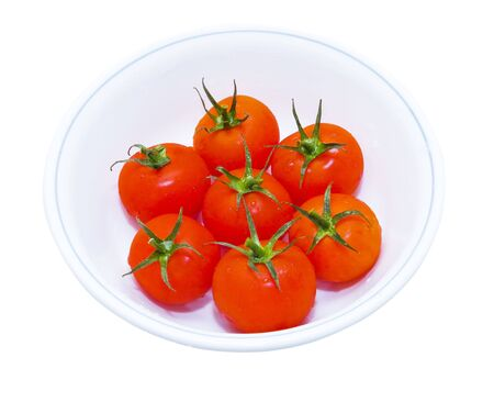 Several red tomatos in round white plate isolated 版權商用圖片