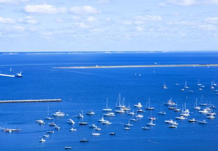 White yachts in blue water of Provincetown, Cape Cod, MA.