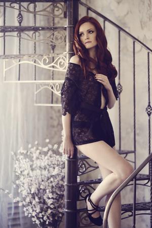 Robe: Beautiful sexy lady in elegant black robe. Stock Photo