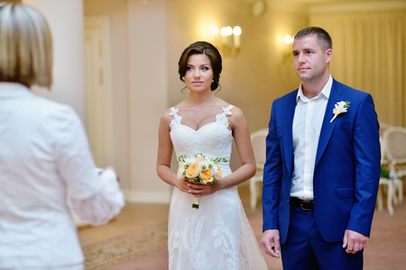 marrying: Beauty bride and handsome groom is marrying. Stock Photo