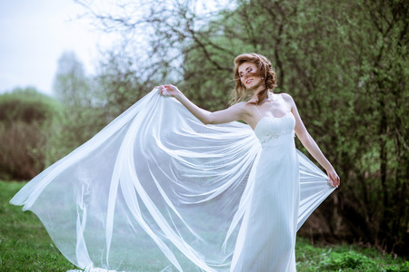 seduce: Blonde bride in fashion white wedding dress with makeup