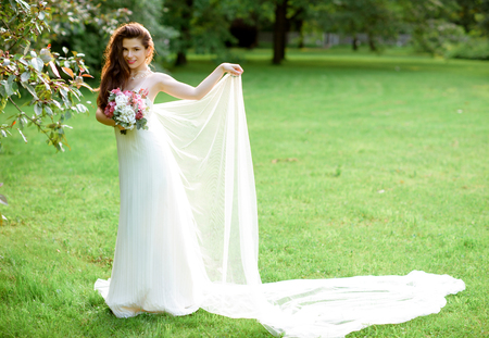 seduce: Brunette bride in fashion white wedding dress with makeup Stock Photo