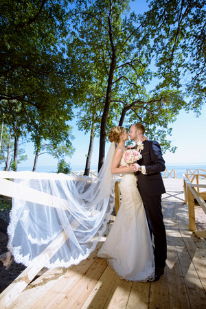 Wedding couple on the nature is hugging each other
