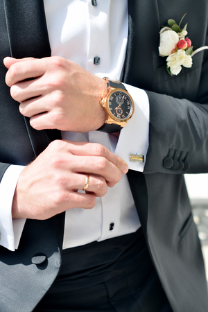 cuff link: Groom is wearing cuff-links indoors