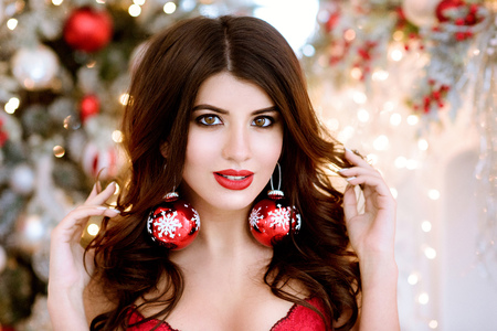 Beautiful brunette sexy Santa Clause in elegant earrings and bra Stock Photo