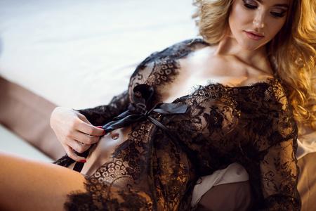Beautiful sexy lady in elegant black robe
