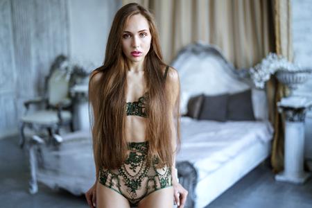 Beautiful sexy lady in green panties and bra Foto de archivo
