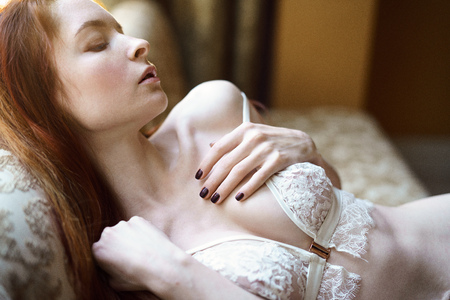 Fashionable female portrait of cute lady in white bra indoors Stock Photo