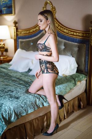 Beautiful sexy lady in green panties, bra and shoes Foto de archivo