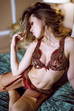 Beautiful sexy lady in red panties and bra on the bed