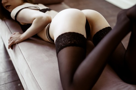 Beautiful sexy lady in elegant black panties and stockings
