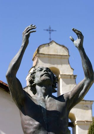 A Statue in front of San Juan Bautista Mission