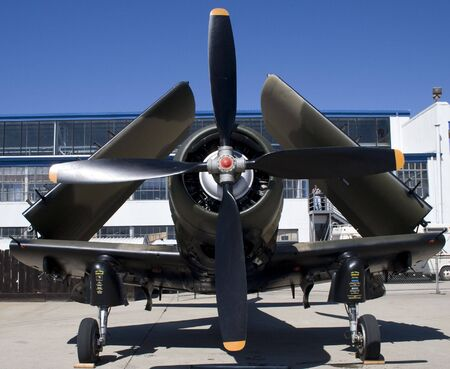 A WWII plane with its wings folded at an airshow