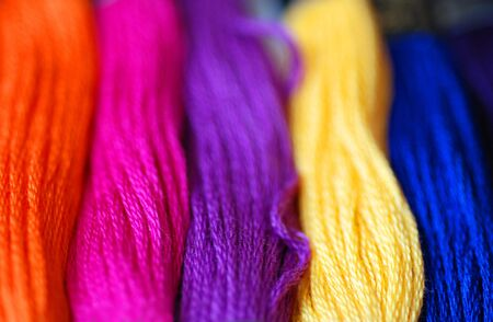 smocking: A close-up of bright and colourful sewing threads