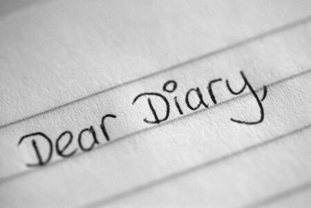 confide: A black and white photograph of the beginning of a teenagers diary entry