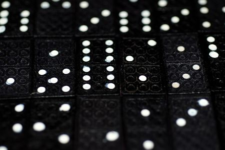 pips: A photograph of rows of domino tiles with splodgy pips on display Stock Photo