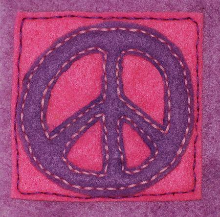An anti-war symbol hand sewn on felt photo