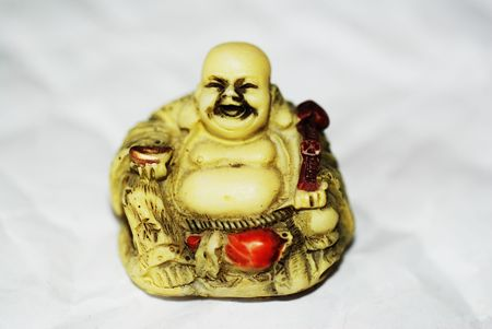 A statue of the laughing Buddha, a symbol of happiness, good luck and plenitude. photo