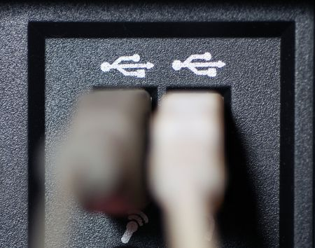 A close-up photograph of USB cable ports with cables photo