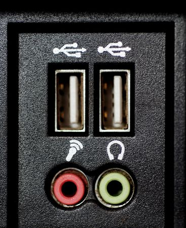 hub: A close-up photograph of a computers USB hub and the sockets for microphone and speakers