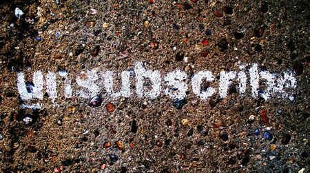unsubscribe: A stencilled graffiti word Unsubscribe, could be used as a button on a website or as a social protest statement