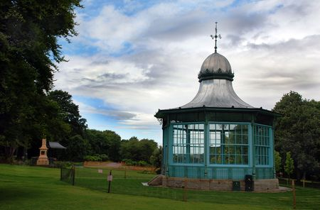 bandstand: A photograph of a bandstand in a public park, under a stormy summer sky