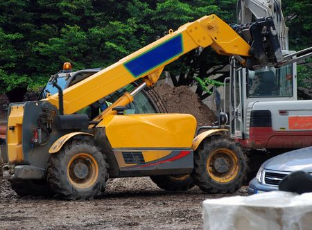 A photograph of a fork-lift truck active on an English building site photo