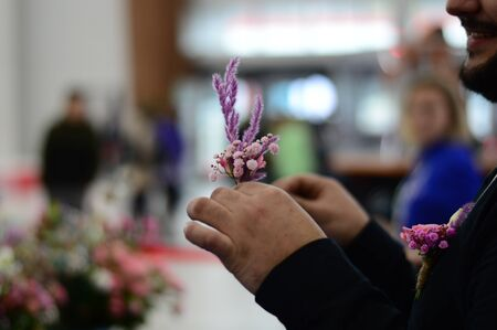 Hand Arranging Flower At school on a blur-blurred background horizontal photo
