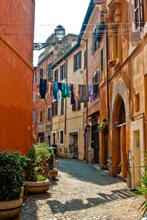 Narrow old street in the city of Rome at daytime Stock Photo
