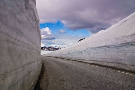 Mountain road with high snow wall in Norway Stock Photo - 5352175