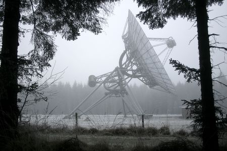 interplanetary: A dish telescope in the forest in winter time