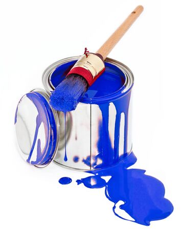 Paint can with dripping brush isolated on white background photo
