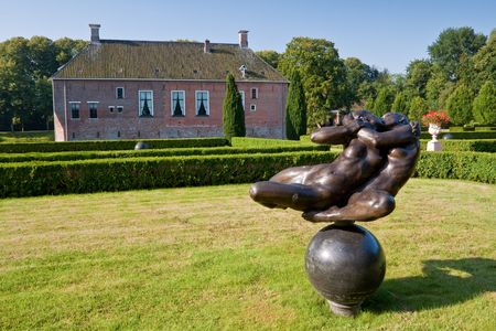 hugh: Old medieval mansion with hugh garden in the Netherlands Stock Photo