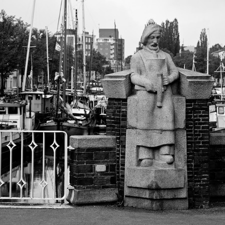 groningen: Statue on a brigde near a harbour in Groningen